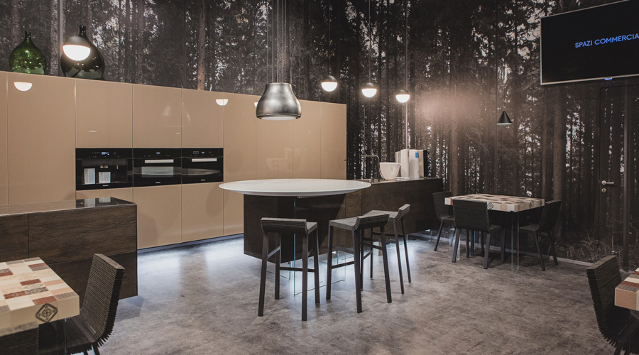 7-2-Lago-Italian-furniture-for-famous-women-Camilla-Lunelli-open-concept-kitchen-living-room-interior-design-beige-sleek-handleless-cabinets-glossy-island-dining-tables-forest-wood-wall-mural