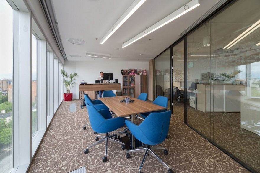 7-2-Mattel-office-interior-design-Russia-Moscow-toys-seller-light-white-walls-beige-carpeting-panoramic-windows-indoor-plants-wooden-desks-blue-chairs-co-working-area-space-zone