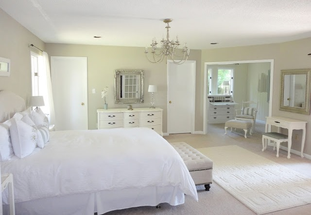 8-1-neo-classical-style-bedroom-interior-design-light-beige-walls-white-furniture-upholstered-bed-dressing-table-caopitone-ottoman-curved-chest-of-drawers-rug-adjoining-room-chandelier-silver-mirror-frames