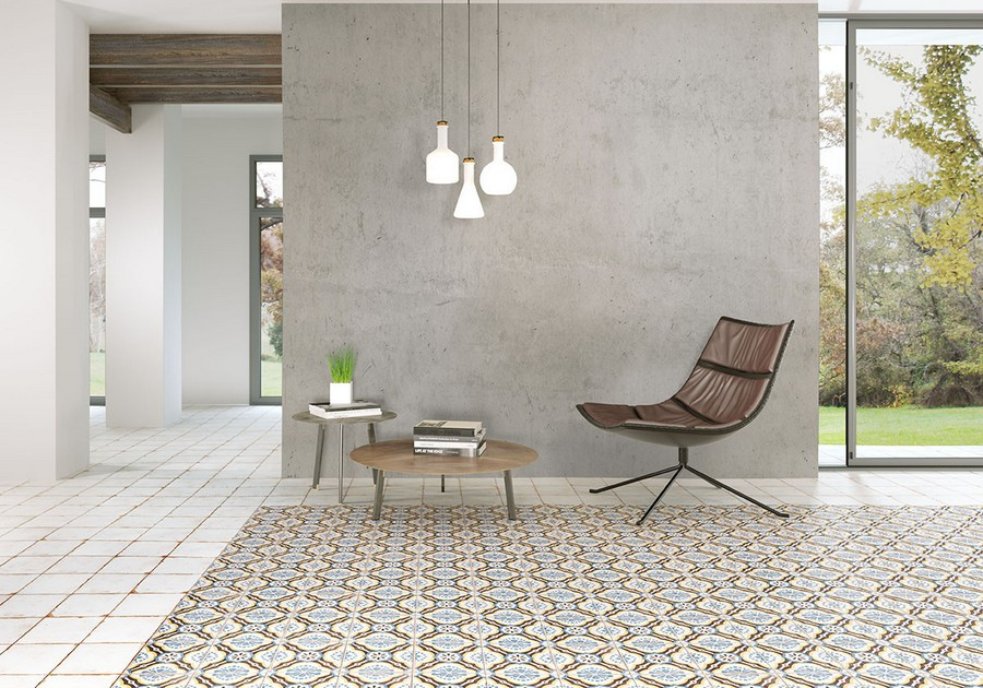 8-10-ceramic-tiles-in-interior-design-lounge-panoramic-windows-chair-coffee-table-ornamental-floor-tiles-faux-concrete-cement-wall-tiles-gray-loft-style-Peronda-brand-collection-2017