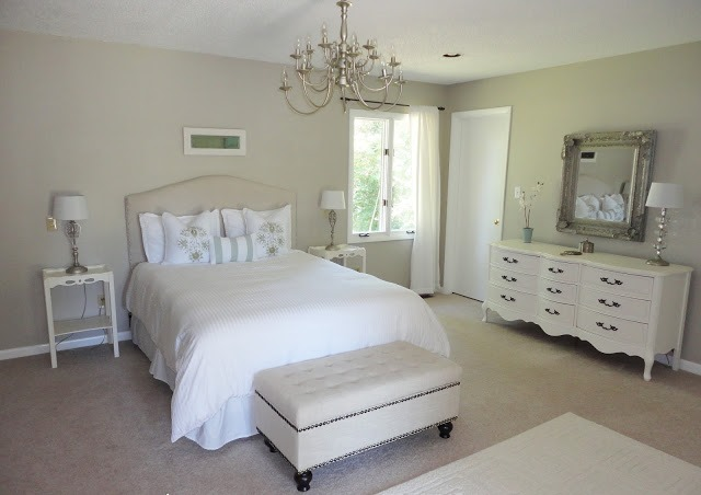 8-2-neo-classical-style-bedroom-interior-design-light-beige-walls-white-furniture-upholstered-bed-caopitone-ottoman-with-rivets-curved-chest-of-drawers-rug-chandelier-silver-mirror-frames-dressing-tables