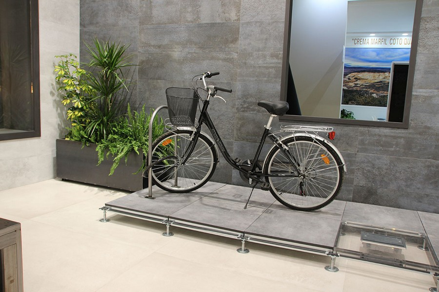 8-3-ceramic-tiles-in-interior-design-gray-loft-style-faux-cement-concrete-pattern-bicycle-Peronda-brand-collection-2017