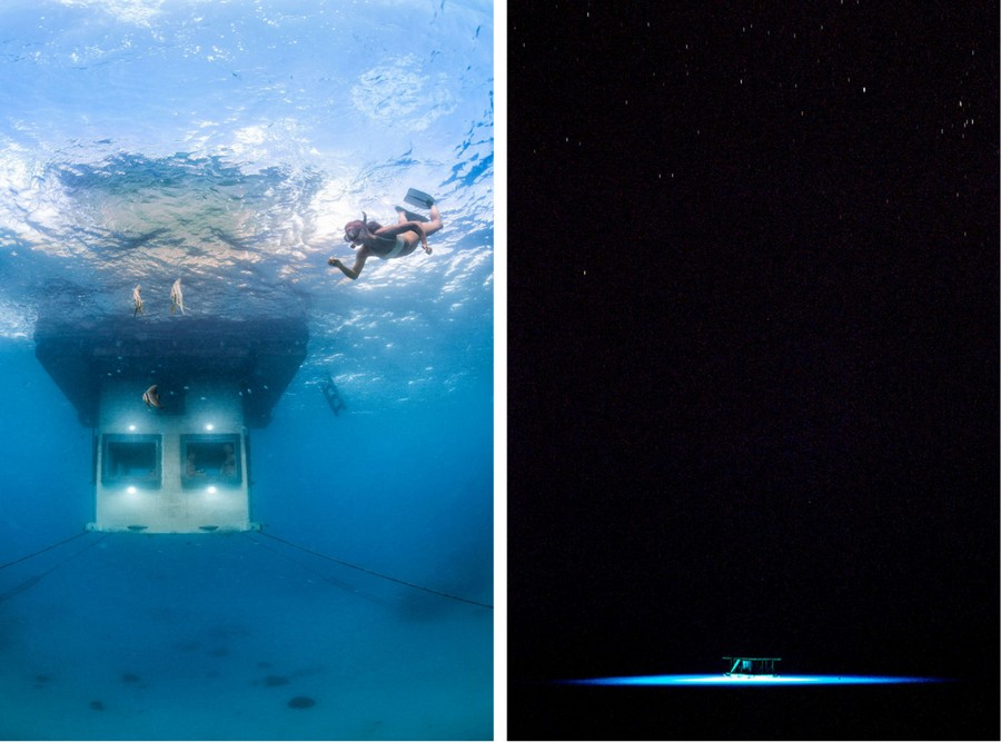 8-Manta-Resort-hotel-Tanzania-Pemba-Island-underwater-under-the-sea-room-woman-diving-under-the-floating-house