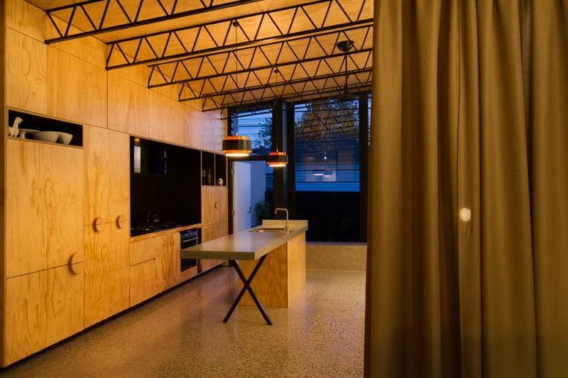 8-elongated-kitchen-interior-design-open-concept-veneer-cabinets-light-plywood-polished-concrete-floor-metal-ceiling-decor-black-backsplash-island