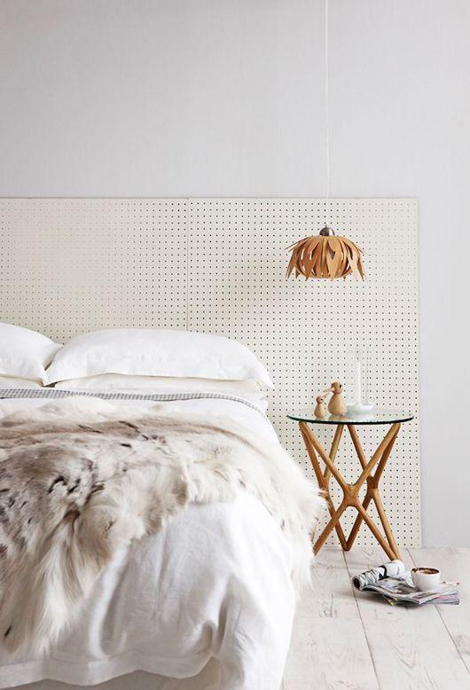 0-1-light-neutral-bedroom-interior-headboard-fur-blanket-bedside-table-geometrical-legs-pendant-floral-lamp