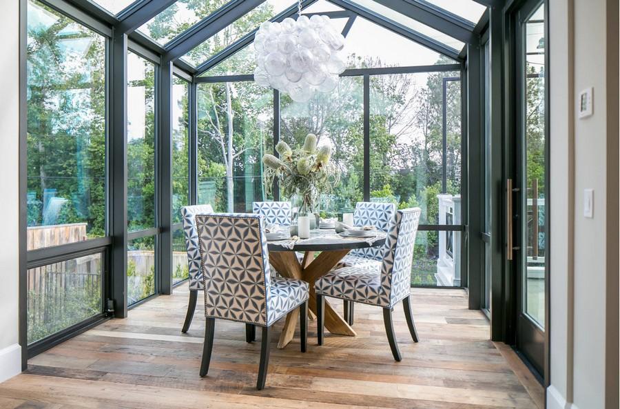 0-dining-room-area-interior-design-ideas-glass-glazed-terrace-verandah-panoramic-windows-stylish-geometrical-pattern-chairs-round-wooden-table