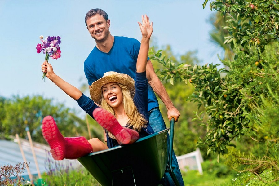 0-happy-family-couple-in-the-garden-gardening-summer-rubber-boots-sun-man-garden-wheels-woman-flowers-happiness-joy