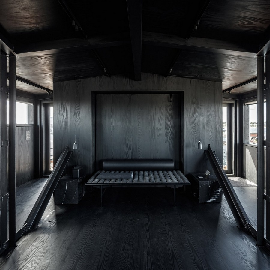 1-6-remade-reconstructed-ex-harbor-crane-apartment-in-Copenhagen-dark-black-graphite-gray-interior-bedroom-leather-bed-marnle-natural-stone-nightstands-pendant-lamps-metal-supports