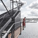 1-8-remade-reconstructed-ex-harbor-crane-apartment-in-Copenhagen-exterior-terrace-with-sea-port-view-girl