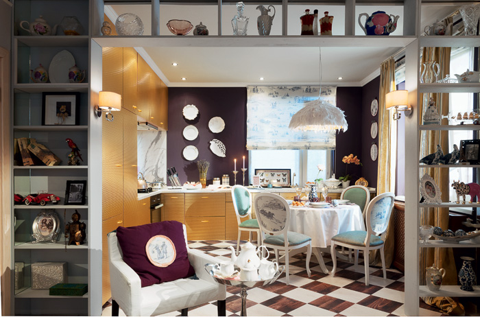 1-French-Parisian-style-kitchen-interior-design-round-dining-table-golden-plastic-cabinets-chessboard-cork-floor-pattern-big-shelving-unit-in-the-doorway-desinger-lamp-lavender-purple-walls-faux-marble-backsplash