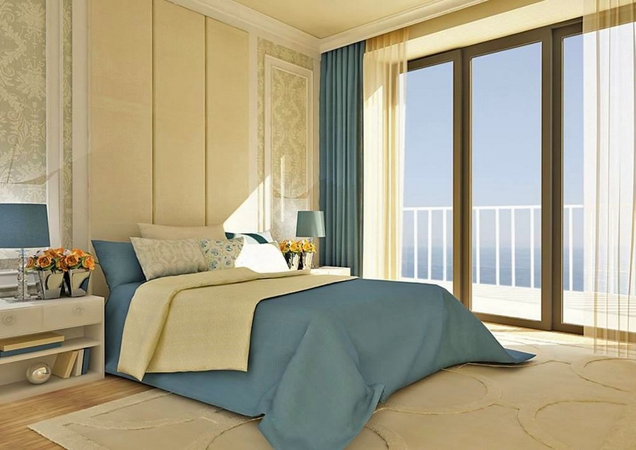 1-contemporary-style-bedroom-interior-design-beige-blue-bed-linen-panoramic-window-sea-view-bedside-lamps-wall-panelling-classical-curtains-carpet-floral-wallpaper