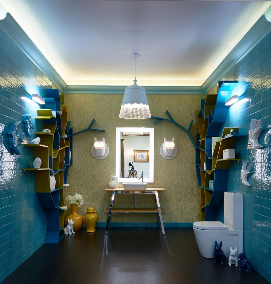 1-creative-bathroom-interior-design-eclectic-eco-style-shelving-unit-tree-shaped-turquoise-blue-glazed-wall-tiles-golden-wallpaper-Omexco-floor-standing-vanity-unit-toilet-mirror-with-lighting-by-Duravit-owl-shaped-sconces