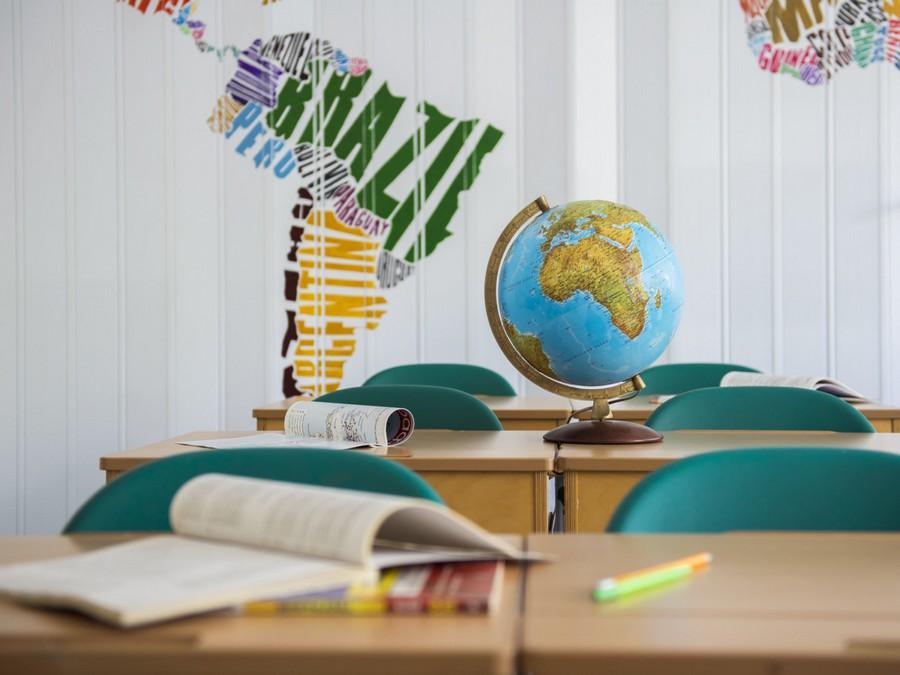 1-creative-beautiful-school-laboratory-interior-design-geography-classes-globe-handmade-acrylic-painted-world-map-bright-multi-colored-folding-doors-desks