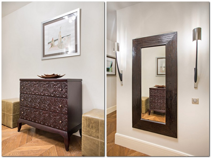1-light-traditional-style-interior-design-entrance-hall-mudroom-ethnic-Thailand-wooden-carved-chest-of-drawers-big-mirror-sconce-wall-lamp-light-gray-walls-oak-parquet-herringbone-pattern