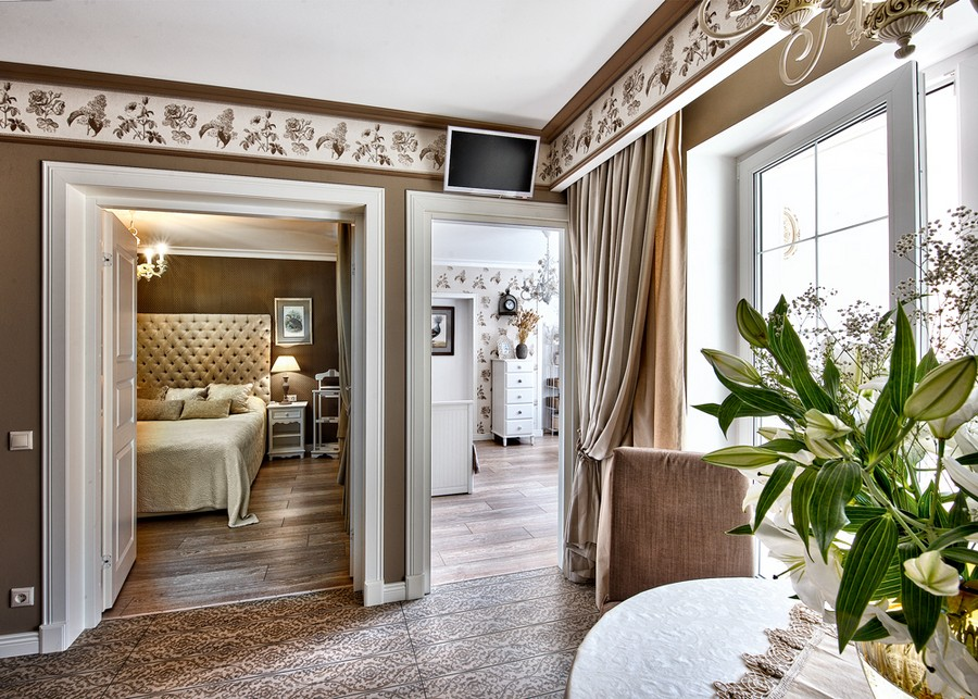 1-neo-classical-style-interior-design-in-beige-brown-and-white-bedroom-exits-wallpaper-strip-frieze-curtains-drapery-dining-table-upholstered-bed-kid's-room-white-chest-of-drawers-laminate-floor-tiles-TV-set-open-concept