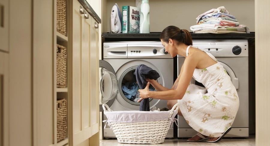 1-woman-loading-washing-machine-in-kitchen