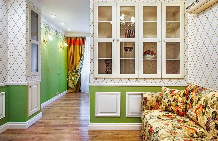 2-1-one-room-apartment-interior-design-ideas-wall-panelling-bi-color-white-and-green-wall-built-in-glass-display-cabinet-cupboard-floral-sofa-curtains-geometrical-motifs-sconces-conditioner