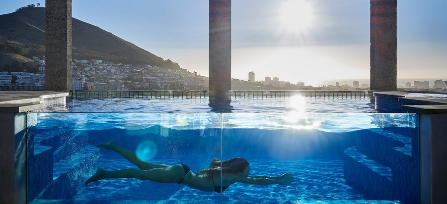 2-11-remade-building-in-South-Africa-Cape-Town-Royal-Portfolio-Hotel-ex-grain-elevator-swimming-pool-on-the-roof-woman-swimming