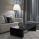 2-3-Armani-Casa-luxurious-interior-design-beige-sofa-living-room-black-coffee-table-curtains-floor-lamp-couch-pillows
