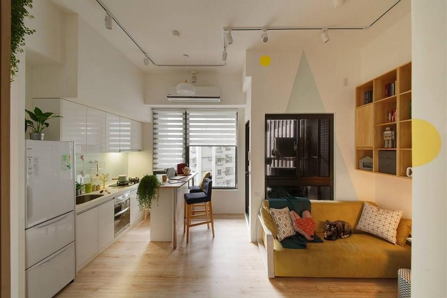 2-3-interior-by-A-Lentil-Design-Taiwan-China-white-walls-light-panoramic-windows-kitchen-open-plan-living-room-lounge-geometric-motifs-white-cabinets-island-yellow-sofa-bookshelves