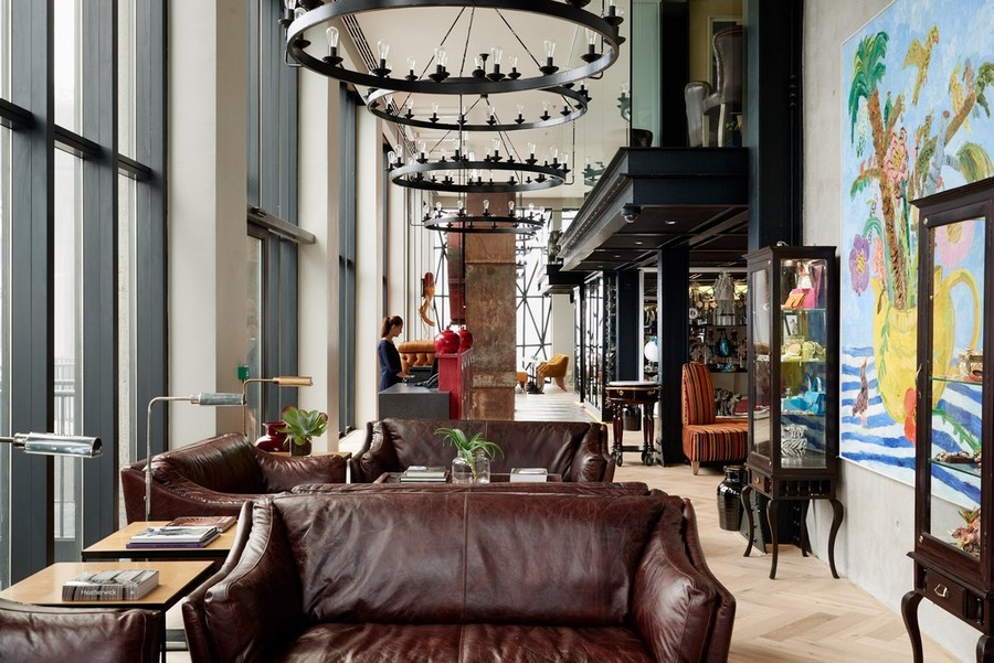 2-4-remade-building-in-South-Africa-Cape-Town-Royal-Portfolio-Hotel-ex-grain-elevator-interior-lobby-hall-reception-desk-leather-sofas-brown-metal-chandeliers-display-cabinets