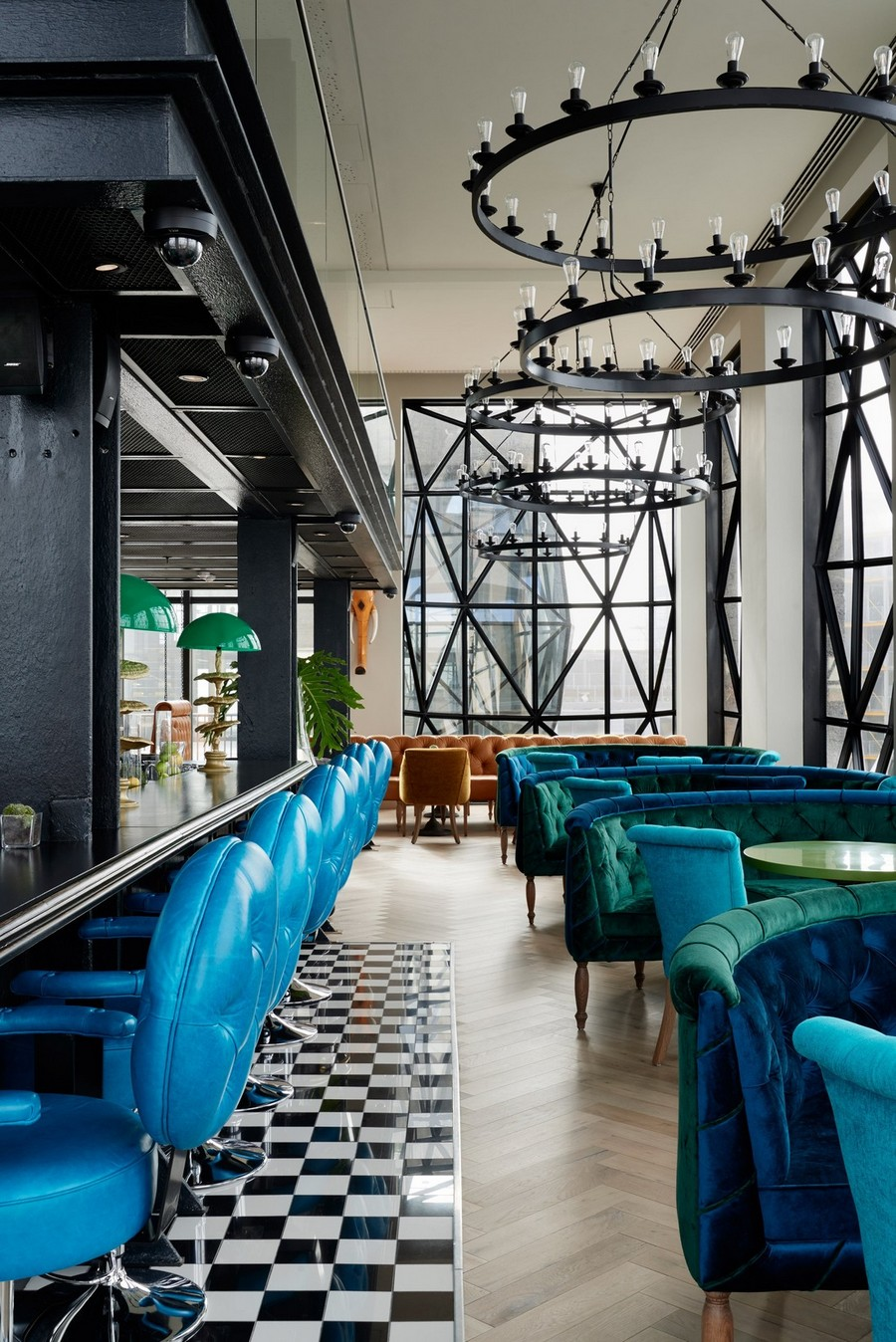 2-6-remade-building-in-South-Africa-Cape-Town-Royal-Portfolio-Hotel-ex-grain-elevator-interior-lobby-bar-restaurant-black-and-white-chessboard-floor-tiles-blue-leather-bar-stools-velvet-curved-couches-sofas
