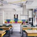 2-creative-beautiful-school-laboratory-interior-design-for-home-economics-classes-white-kitchen-cooking-area-bright-multi-colored-backsplash-folding-doors-desks-island-multifunctional