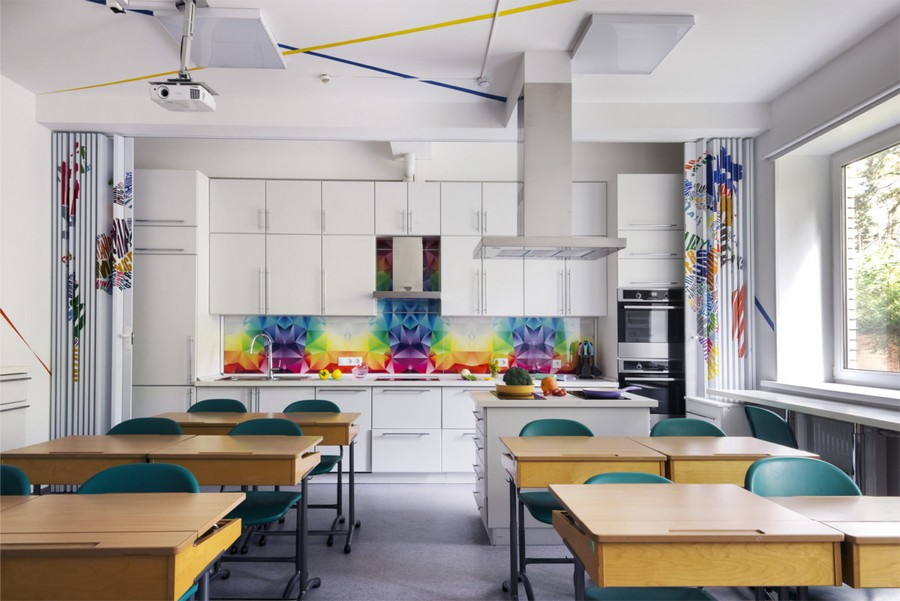2-creative-beautiful-school-laboratory-interior-design-for-home-economics-classes-white-kitchen-cooking-area-bright-multi-colored-backsplash-folding-doors-desks-island-multifunctional