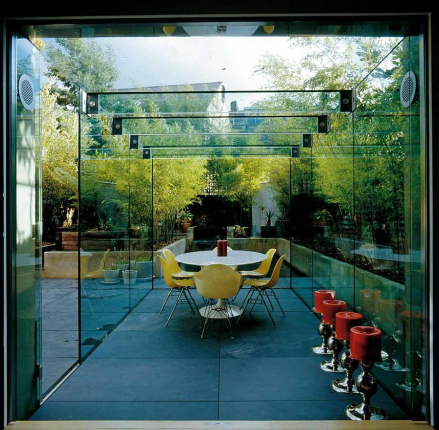 2-dining-room-area-interior-design-ideas-glazed-glass-terrace-ensuite-verandah-house-extension-roudn-table-bright-yellow-cahirs-red-bar-stools-panoramic-windows