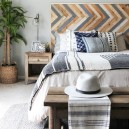 2-eco-style-bedroom-interior-design-wooden-planks-headboard-multi-colored-bedside-table-bench-wooden-nightstand-eco-style-minimalism-gray-wall-floor-indoor-plant-in-wicker-basket