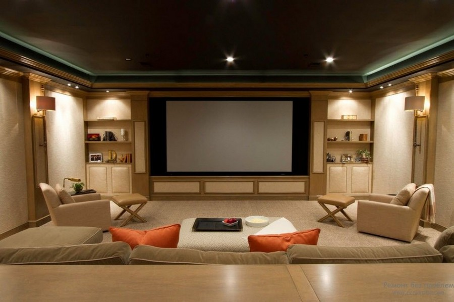 2-home-theater-home-cinema-movies-in-interior-design-TV-screen-beige-walls-traditional-style-lounge-arm-chairs-comfy-sofa-orange-throw-pillows-spot-lights-wall-lamps-shelves-accent-lights