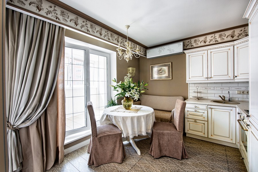 2-neo-classical-style-interior-design-in-beige-brown-and-white-kitchen-dining-area-wallpaper-frieze-backsplash-air-conditioner-round-folding-table-IKEA-chairs-slip-covers-floor-tiles-couch-drapery-wall-art-chandelier