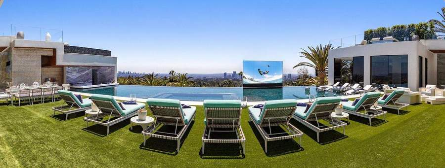 2-the-most expensive-home-in-USA-beyonce-jay-z-Los-Angeles-bel-air-luxurious-exterior-design-green-lawn-75-foot-swimming-pool-with-pop-up-movie-TV-screen-outdoor-chaise-lounges-sunbathing