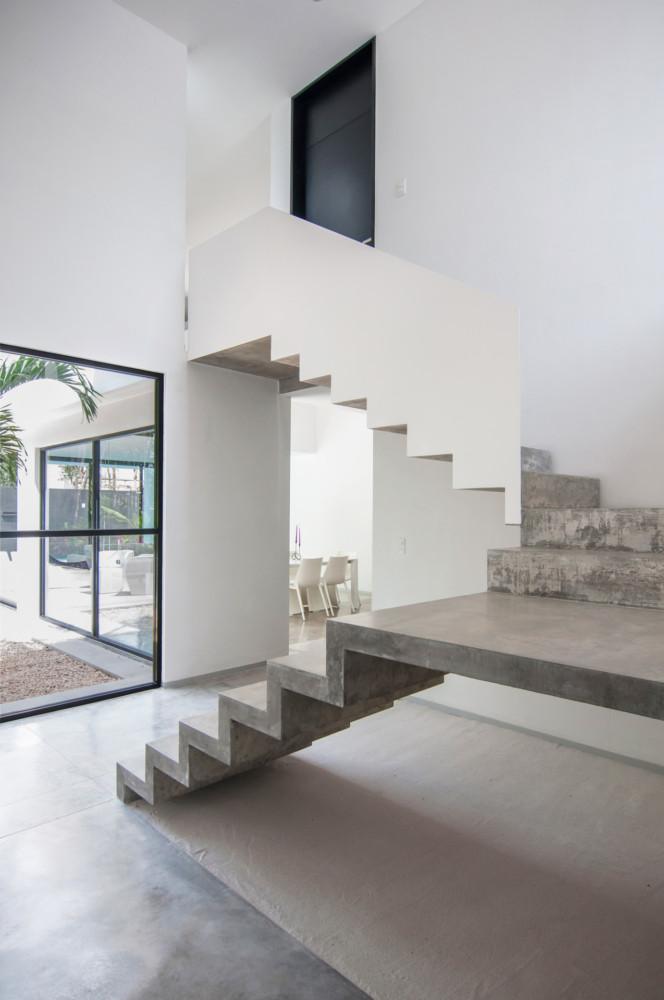 3-2-concrete-staircase-stairs-white-railing-walls-minimalist-style-interior-design