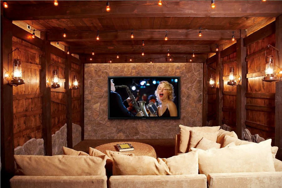 3-2-home-theater-home-cinema-movies-in-interior-design-country-style-wooden-walls-beams-holiday-lights-bulbs-wall-lamps-lanterns-beige-comfy-sofa-brown-wood-stone-wall-wicker-coffee-table