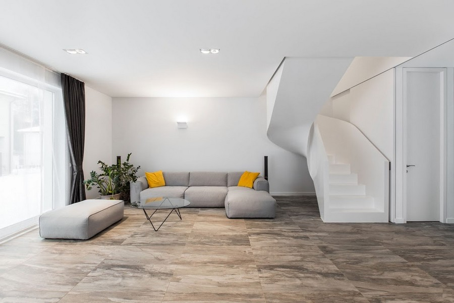 3-4-concrete-staircase-stairs-minimalist-style-interior-living-room-gray-sofas-yellow-accents-throw-pillows