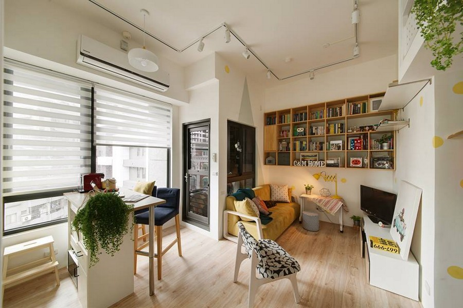 3-interior-by-A-Lentil-Design-Taiwan-China-white-walls-light-panoramic-windows-venetian-blinds-laminate-open-plan-kitchen-island-dining-area-living-room-TV-stand-yellow-sofa-bookshelves-wall-recess-balcony-exit-bar