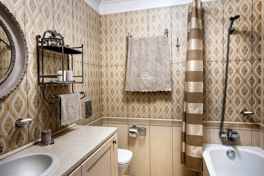 3-neo-classical-style-interior-design-in-beige-brown-and-white-bathroom-bathtub-two-types-wall-tiles-Victorian-baseboard-wrought-whatnot-accessories-towel-drying-radiator-countertop-wash-basin-mirror-oval-toilet-paper-holder