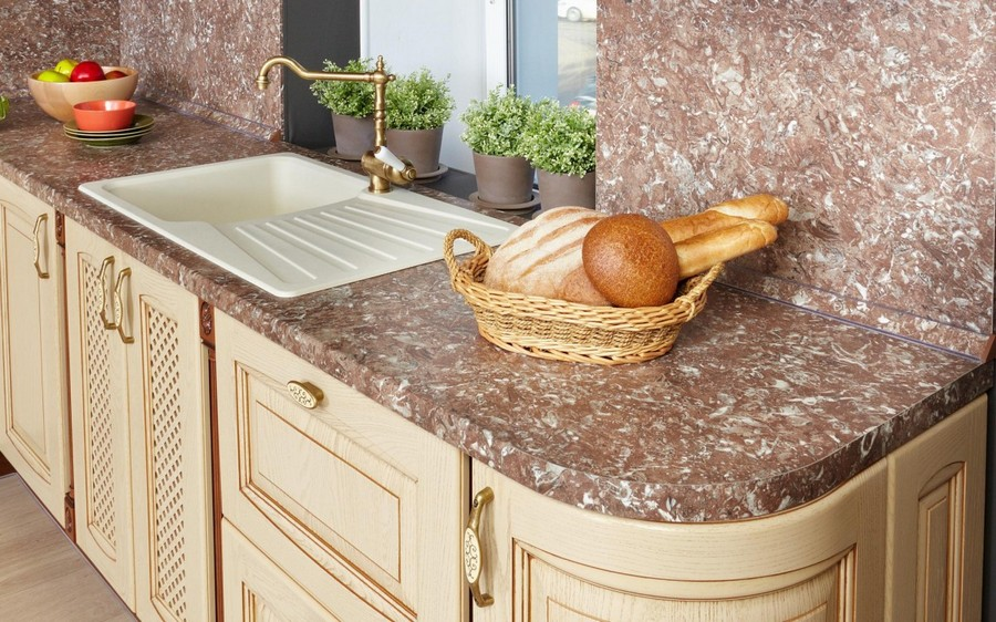 3-original-creative-kitchen-backsplash-ideas-in-interior-design-monolithic-seamless-worktop-brown-beige-artificial-faux-stone-composite-material-retro-style-cabinets-faucet-white-sink-brass-accessories
