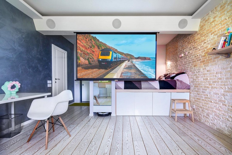 3-studio-apartment-interior-design-ideas-faux-concrete-wall-brutal-gray-loft-bed-industrial-style-brick-masonry-big-TV-set-writing-desk-chair-white-wooden-floor