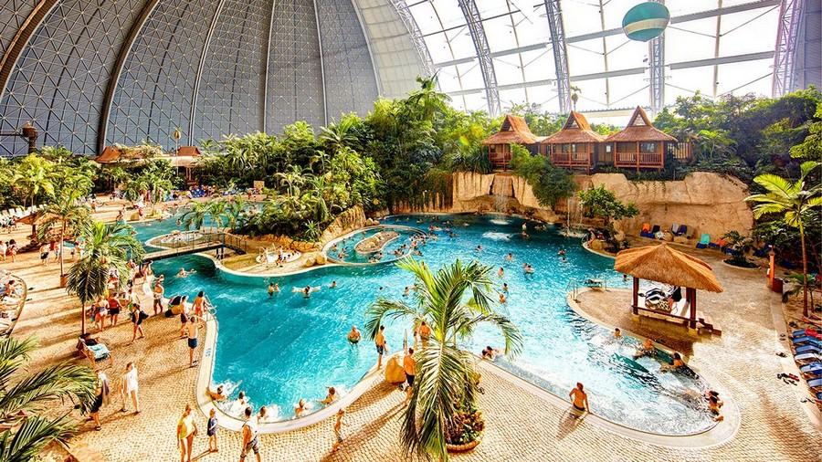 4-1-das-tropical-island-resort-germany-indoor-water-park-swimming-pool-waterfall-palms-straw-huts