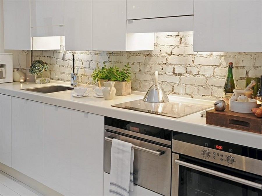 4-original-creative-kitchen-backsplash-ideas-in-interior-design-in-minimalist-style-faux-brick-wall-tiles-white-handleless-push-to-open-cabinets