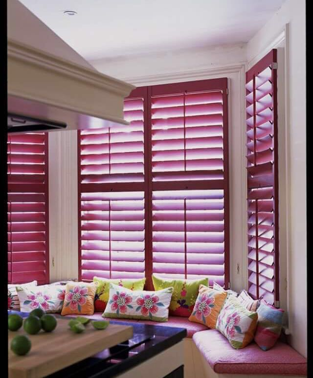 4-red-window-shutters-in-kitchen-interior-design-window-sill-bench-throw-pillows-bay-window
