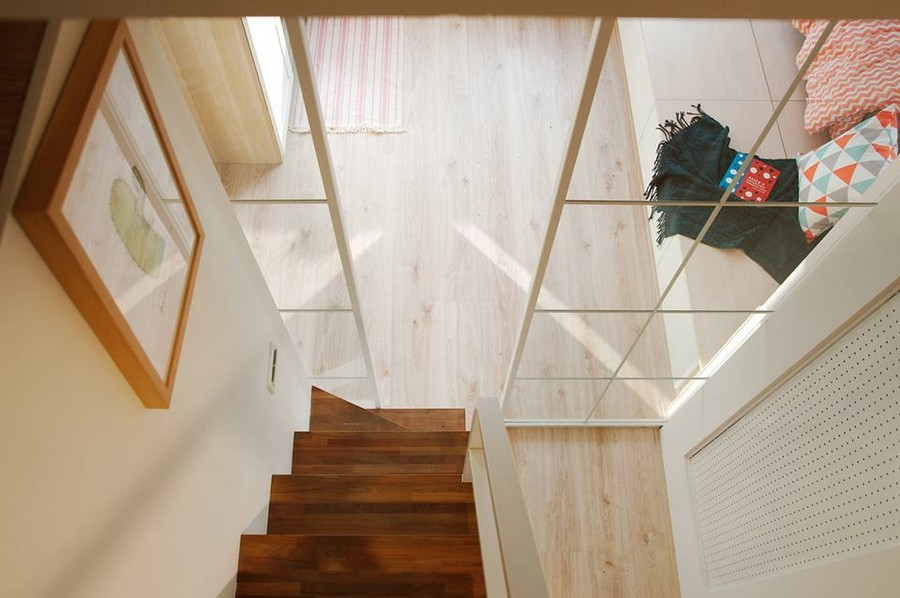 5-1-interior-by-A-Lentil-Design-Taiwan-China-white-walls-light-laminate-view-from-attic-loft-room-mezzanine-glass-sliding-doors