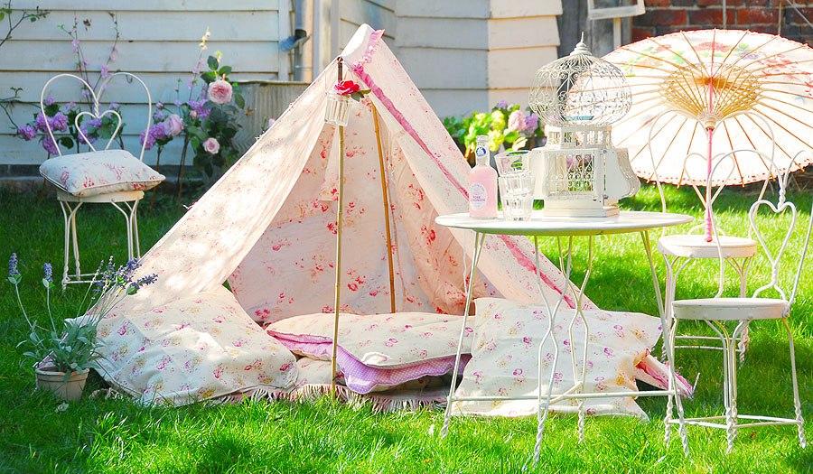 5-handmade-garden-hut-teepee-wigwam-tree-branches-blankets-throw-pillows-girl's-shelter-umbrella-wrought-white-furniture