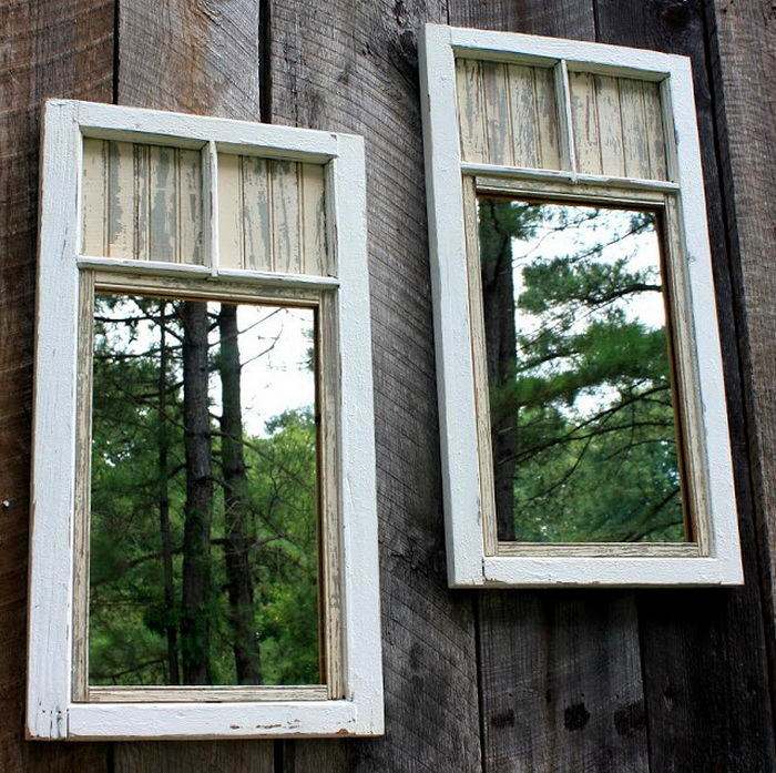 7-mirrors-in-window-frames-on-a-garden-fence