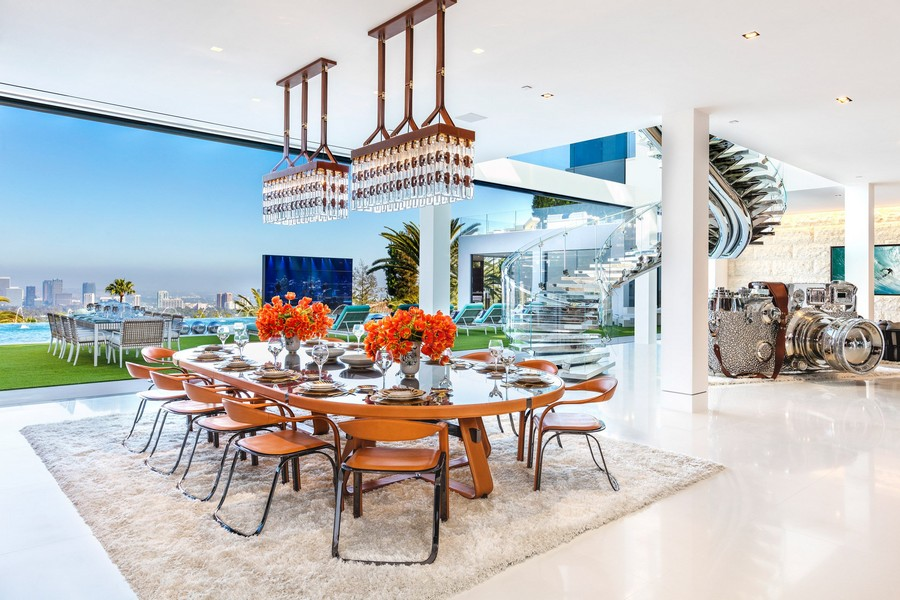 7-the-most expensive-home-in-USA-beyonce-jay-z-Los-Angeles-bel-air-luxurious-interior-design-dining-room-open-concept-area-orange-chairs-oval-table-spiral-staircase-panoramic-windows-Leica-model