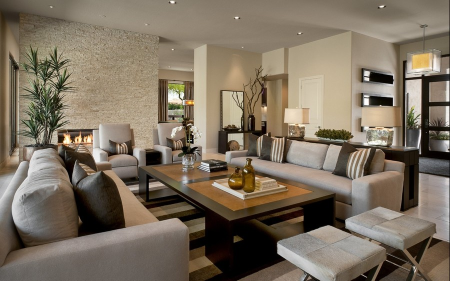 8-spot-lights-in-living-room-interior-design-gray-sofas-stools-coffee-table-fireplace-contemporary-style-console-table-lamps-beige-walls-brown-furniture
