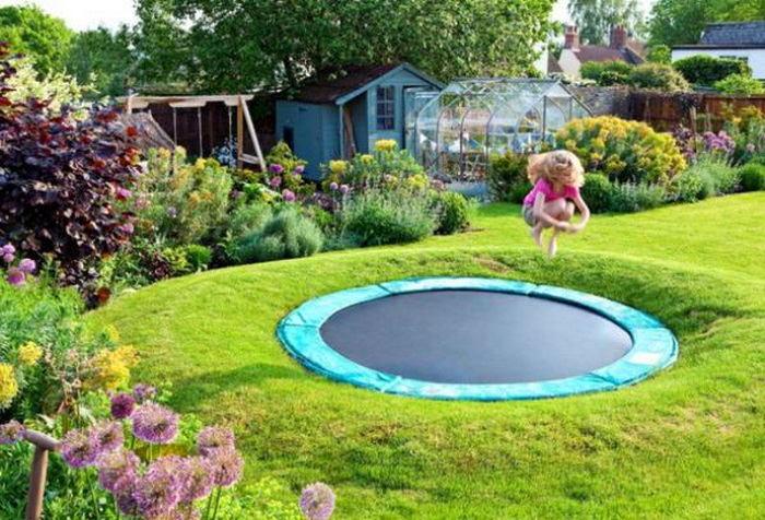 8-sunken-dug-in-ground-trampoline-little-girl-jumping-outdoor