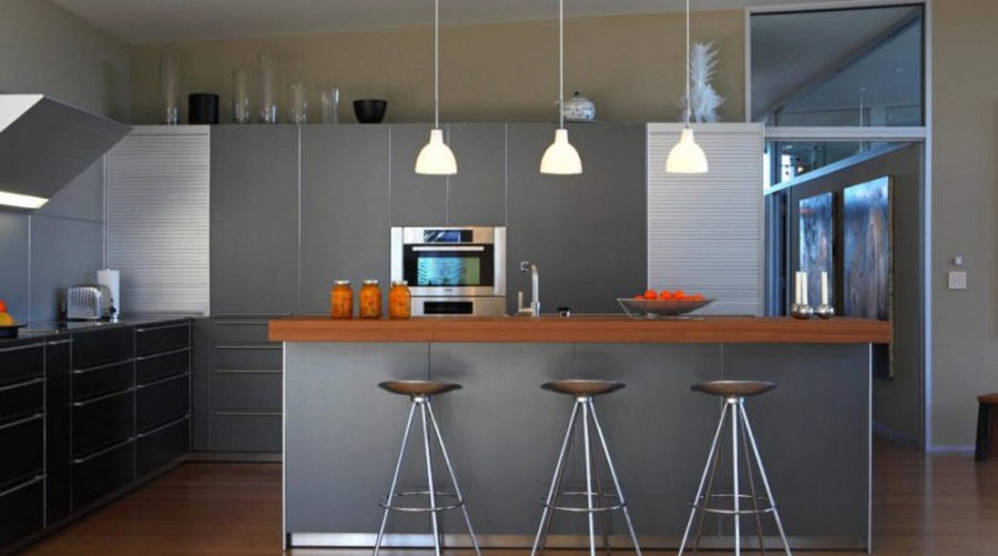 9-dining-room-area-interior-design-ideas-chic-gray-kitchen-cabinets-suite-island-wooden-countertop-sleek-white-pendant-lamps